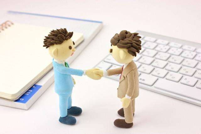 握手で商談成立